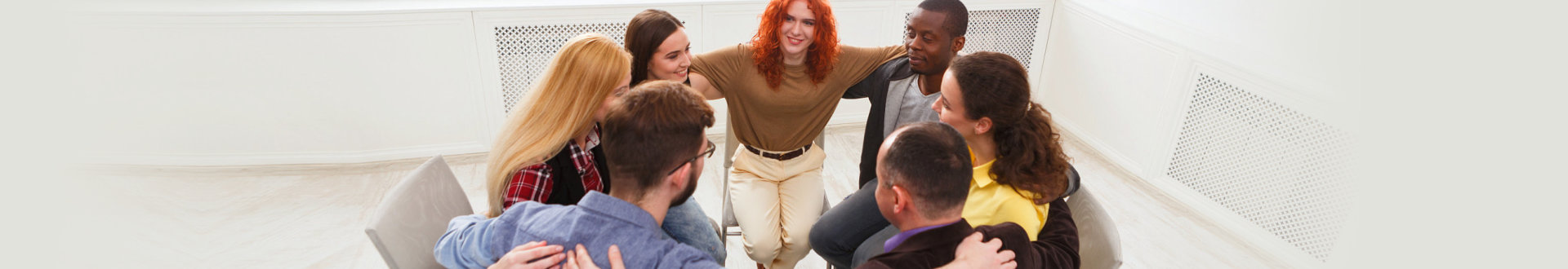 group of people holding together on therapy session